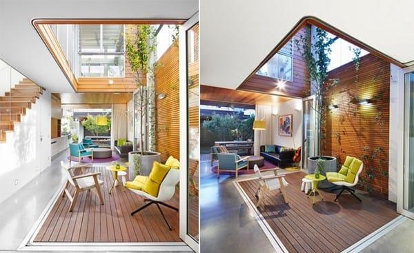 Liệu có ai không thích thiết kế mở này không? Không gian xanh được mở thông với tầng phía trên. Bạn có thể bố trí thêm một chậu cây và một vài chai rượu vang để nhâm nhi trong khung cảnh tuyệt vời này nữa nhé.