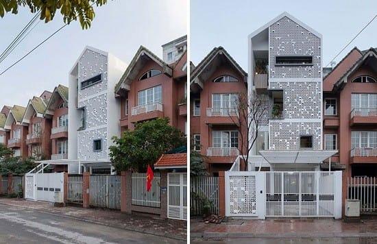 Ngôi nhà nằm trong một khu biệt thự liền kề đang bị bỏ hoang nhưng nổi bật hơn hẳn với màu sơn trắng tinh khôi và thiết kế độc đáo.